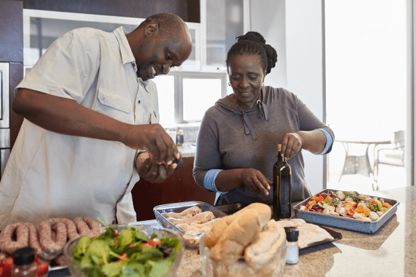 Couple preparing a healthy meal at home.
