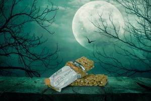 Crunchy Peanut Pretzel Bar in front of Full Moon