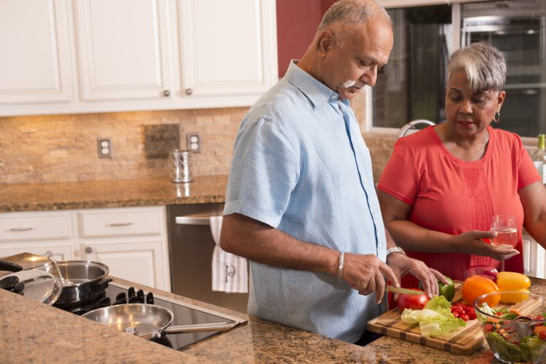 Couple enjoying a healthy meal at home.