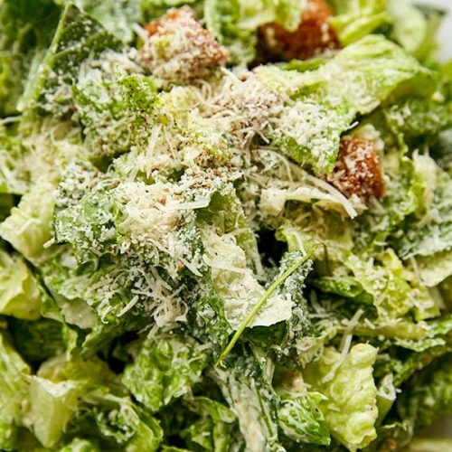 Caesar Salad Topped with Cheese