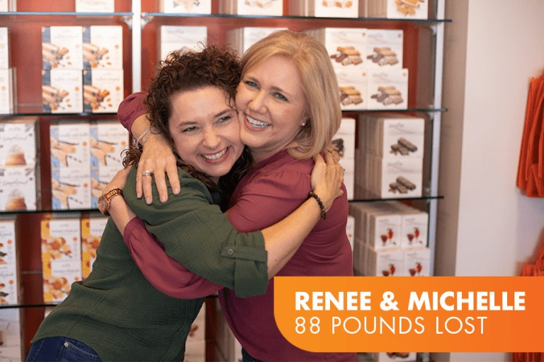 Renee and Michelle lost 88 pounds on Profile. Photo of two friends hugging.