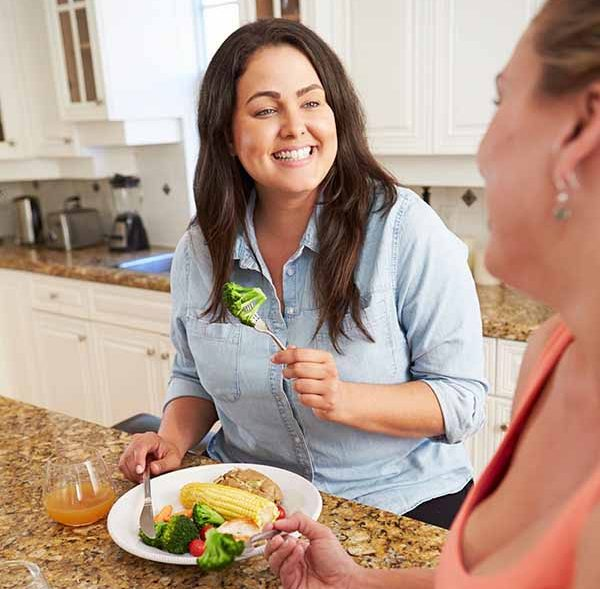 two women eating a healthy dinner
