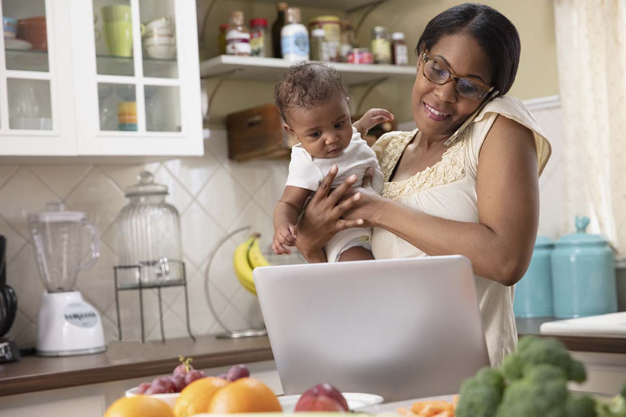 mom with child cooking healthy profile by sanford