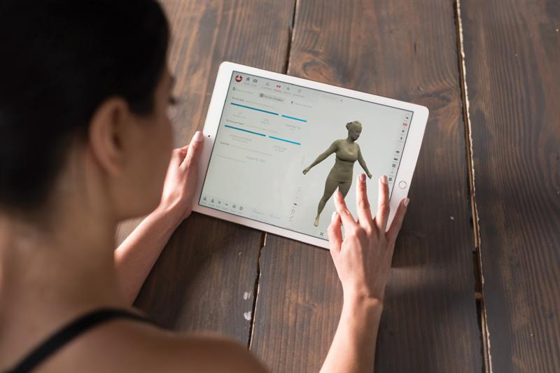 Woman holding 3D body scan report, Profile member