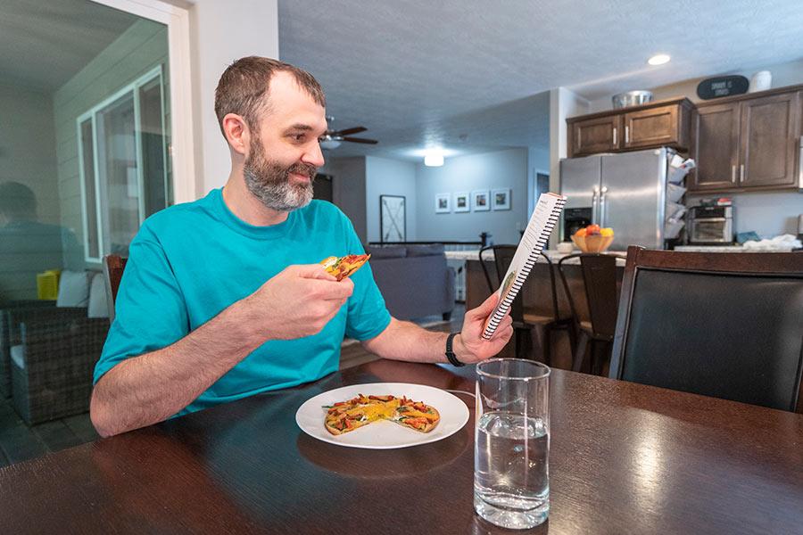 Male Profile member, man eats healthy pizza